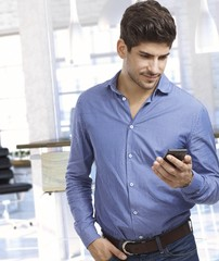 Young man looking at smartphone