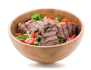 Salad with steak isolated on white background