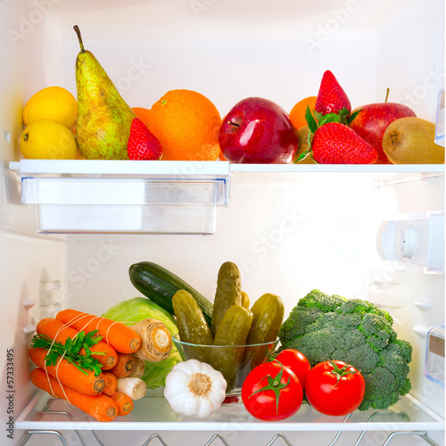Fridge full of healthy fruits and vegetables