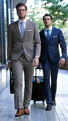 two young executives arriving at the hotel