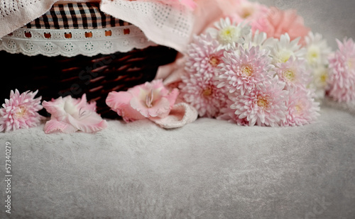brown wicker basket with delicate pink chrysanthemums