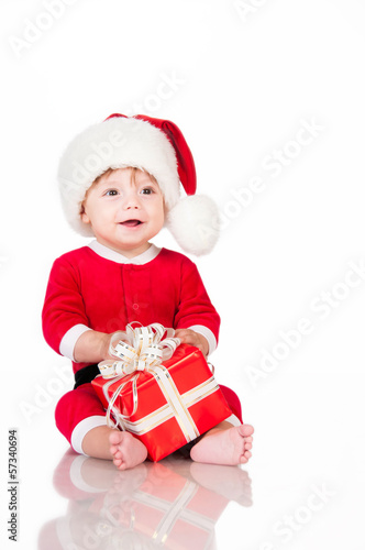 Cheerful little Santa Claus with presents.