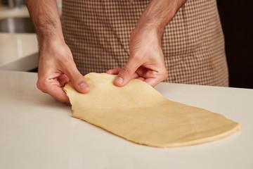 Baker preparing brioche dough