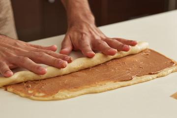 Baker rolling brioche dough