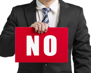 "Businessman use one hand to hold a red board with word ""No"" clos"