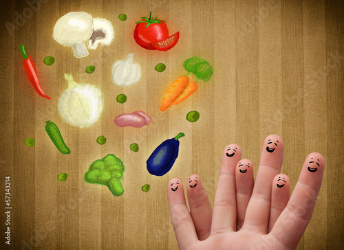 Happy smiley face fingers looking at illustration of colorful he