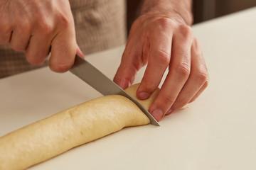 Baker cutting brioche dough