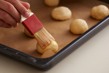 Hand painting raw brioche dough