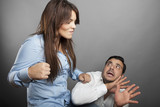 Girl threatens with a fist his boyfriend