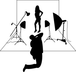 Model posing in studio in front of the photographer layered