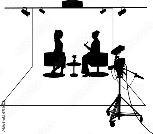 Journalist interviewing a guest in a TV studio  layered