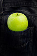 Green apple in Jeans pocket