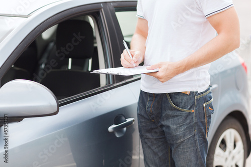 man with car documents