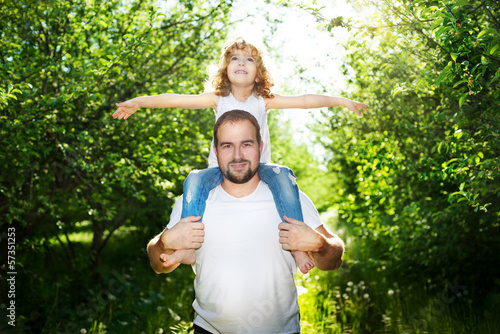 daughter with her father together outdoors