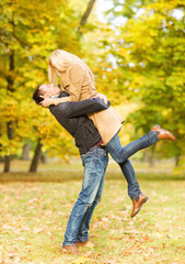 romantic couple playing in the autumn park