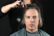 Man Getting Long Hair Combed In Preparation For Cut
