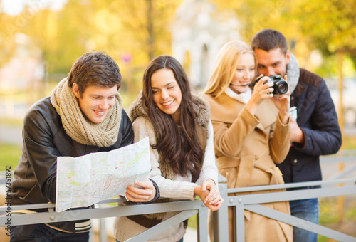 couples with tourist map and camera in autumn park