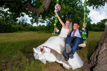 Groom and  bride  on swing