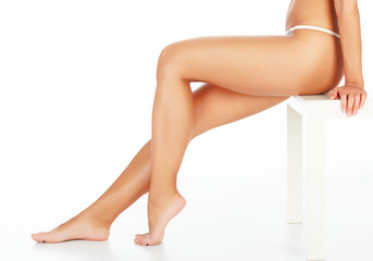 Female legs on white background, copyspace