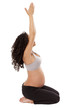 A pregnant woman stays fit with yoga.