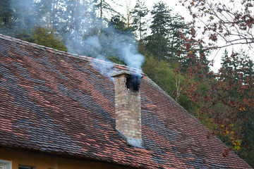smoke from the chimney of the old house