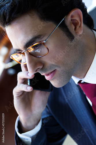 young businessman with smartphone