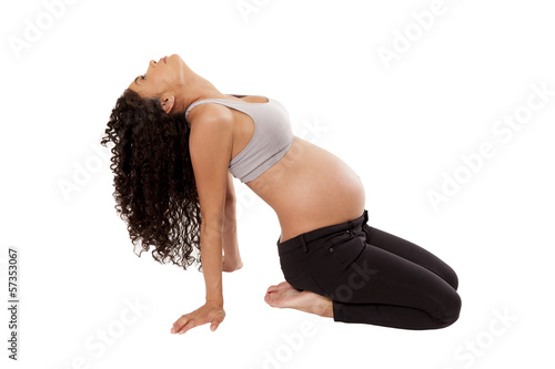 Yoga moves performed by a pregnant woman.