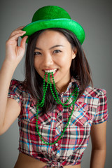 Portrait of sexy asian cowgirl for st patrick's day