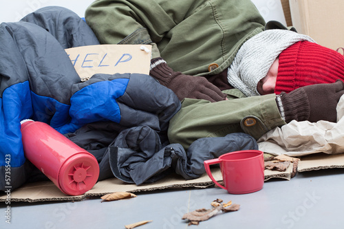 Homeless sleeping on the ground