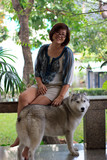woman and siberian husky dog