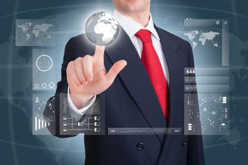 Businessman pointing to an earth globe on a touchscreen