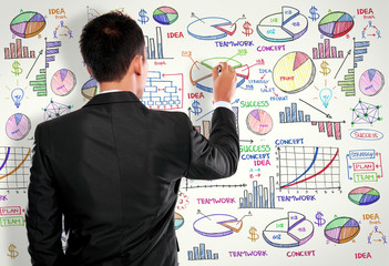 Businessman drawing modern business concept on white