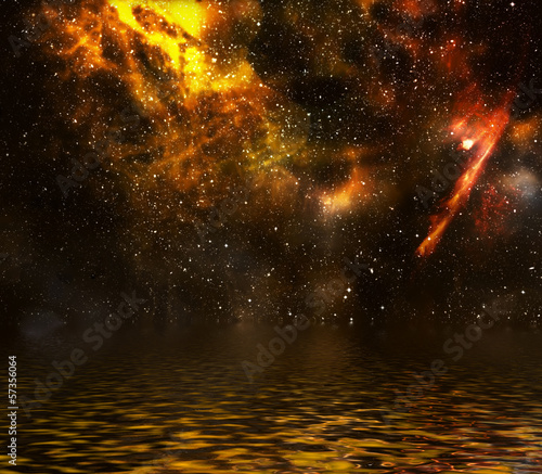 Star field with nebula and galaxy reflected in water surface.