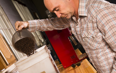 Production House Owner Weighing Roasted Coffee Packaging