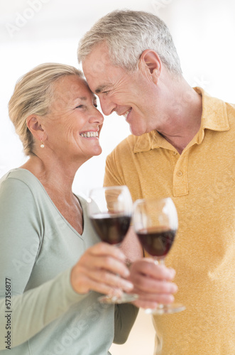 Couple Toasting Wineglasses At Home
