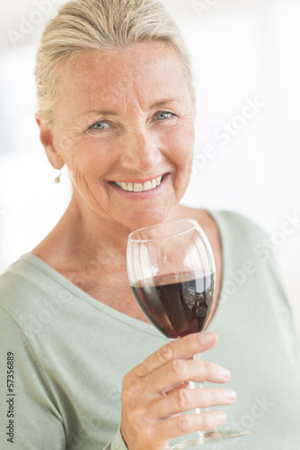Happy Woman Holding Wineglass At Home