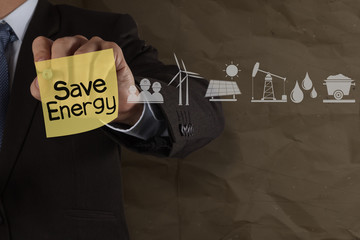 businessman hand draws save energy on sticky note with icons and