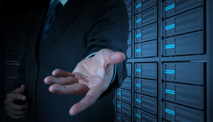 businessman open hand and server room background