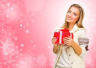 Girl with gift box on winter background