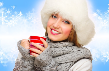Girl with mug on winter background