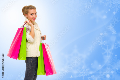Girl with bags on winter background
