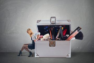 Young attractive woman pushing big hevy luggage