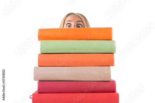 girl with big eyes looking for stack of books