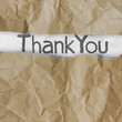 hand drawn thank you words on crumpled paper with tear envelope
