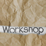 hand drawn workshop words on crumpled paper with tear envelope a