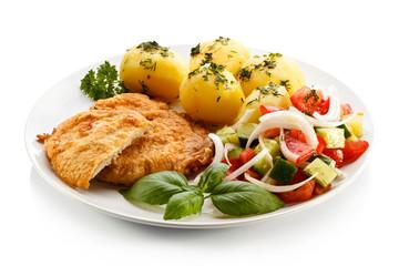 Fried pork chops, boiled potatoes and vegetable salad