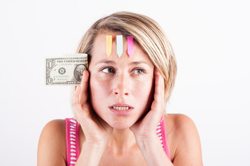 Young woman thinking about her finances holding in her hand a do