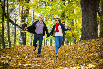 Urban leisure - woman and man running in park