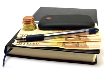 notebook, mobile, pen, coins and banknotes