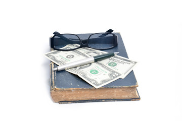 old books with eye glasses and money